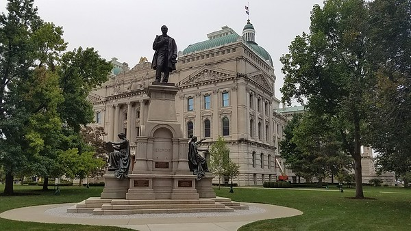 Thomas A Hendricks statue (former Indiana Governor and Vice President of the US) with the Indiana State House in the background (Capitol Building).