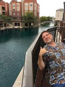 Mike sitting on the balcony of the hotel along the canal.