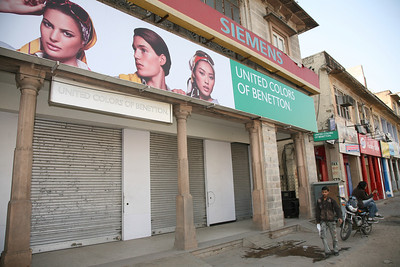 Uh oh -- looks like Benetton Jaipur is closed! Good thing the guy on the motorcycle is about to open the store.