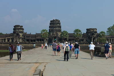 Angkor Wat.  A walkway across the moat from the outer wall to the next interior rectangular wall (with buildings).