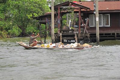 Vendor bringing fresh fruit and sundries to residents along the Khlong Bangkok Noi (the former Chao Phraya River).