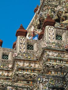 Wat Aroon (Temple of Dawn)  Joseph Van De Water taking a photograph.