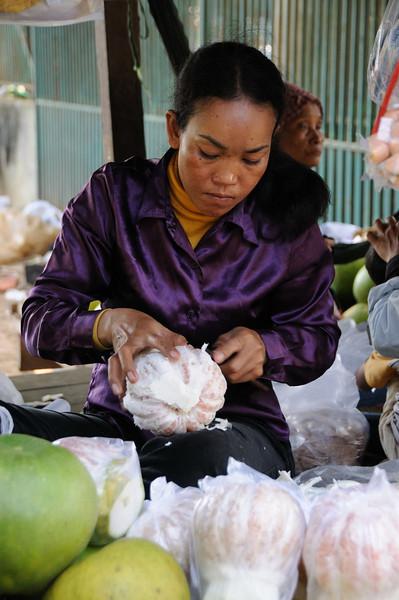 Preparing Pomelos near Skun Pagoda, north of Phnom Penh.