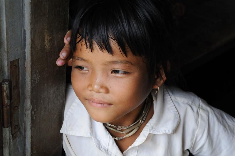 Looking out of school window in Kampong Phulk village.