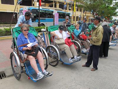Deborah Cobb, Gretchen Lengyel and Sherri Paul in Cyclos (tricycle rickshaws).