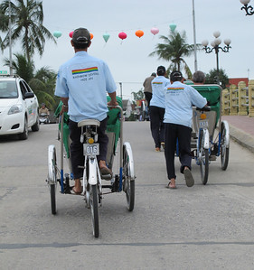Cyclo drivers traversing a bridge in Hoi An -- sometimes too much to peddle with a passenger on board.