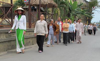 Tourists along Thu Bon River in Hoi An.