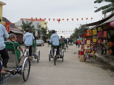 Ray Cabano and others in cyclos in Hoi An.