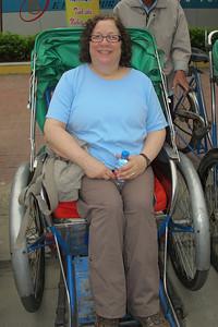 Renee Mirsky in a Cyclo (tricycle rickshaw).