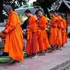 Early morning offering of alms in Luang Prabang, Laos.