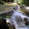 One of the many waterfalls at Tat Kuang Si, south of Luang Prabang, Laos.