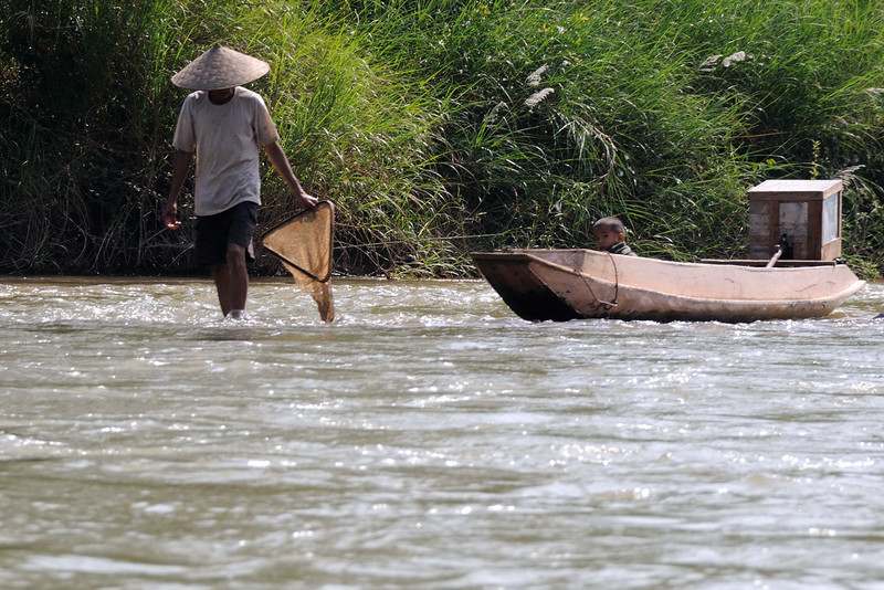 Fisherman in Nam Ou river.