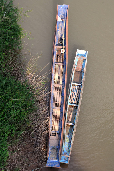 Boats on Nam Ou river photographed from the Chinese built bridge at Nong Khiaw