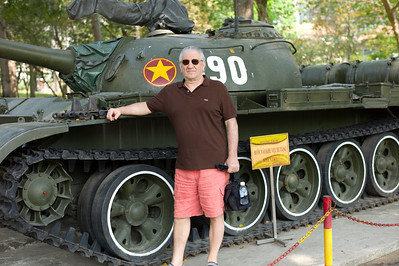 David Minker alongside Tank 390 at the Reunification Palace, Saigon.  This tank and another (843, not shown here) on the palace grounds were used to break through the gates of the palace by the North Vietnamese Army on April 30th 1975 which then lead to the fall of the South and the end of the Vietnam War.  Tank 843 is a Russian made T54 tank while tank 390 is a Chinese made T59 tank.