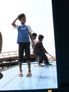 Young boys working the motor boat on the canal to Tonle Sap Lake.