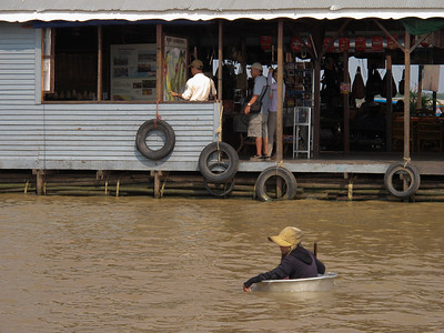 Floating in a tub with a paddle in Tonle Sap Lake.
