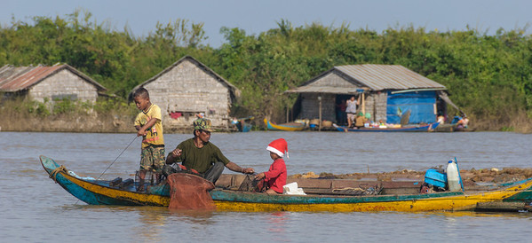 Even Santa is helping the fishing chores of the family.