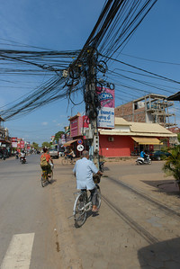 Overhead wires. Everywhere in SE Asia (and India) you see tangles of wires. Instead of tracing a bad line, a new one is installed.