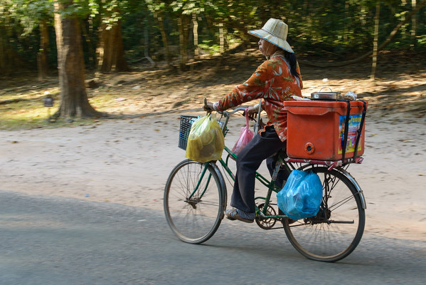 Angkor is an enormous place, so the locals get around on bikes or motor bikes.