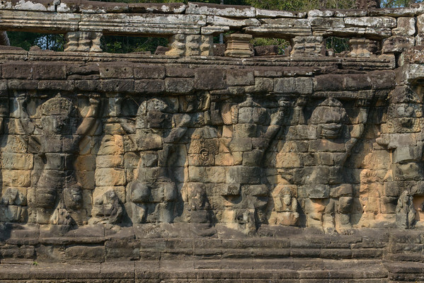 Angkor Thom. The central section of the Elephant Terrace has carved statues of garudas.