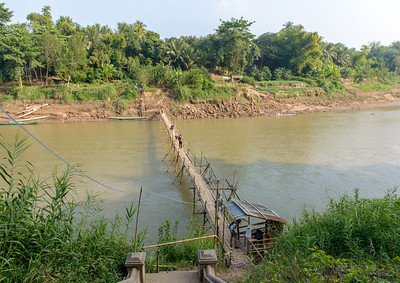 A bamboo bridge across the Nam Khan River (which flows into the Mekong River).
