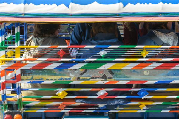 A brightly painted tuk-tuk (motorized rickshaw).