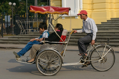 Cyclos or bicycle rickshaws. Commonly seen in Hanoi.