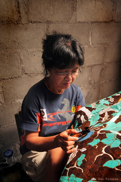 A woman making batik