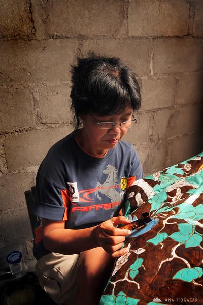 A woman making batik