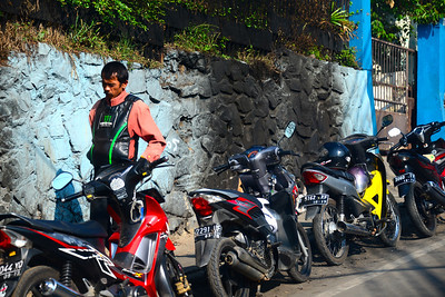Ojek! Only an intrepid traveler will take one of these 'ojek' motorbike taxis!
