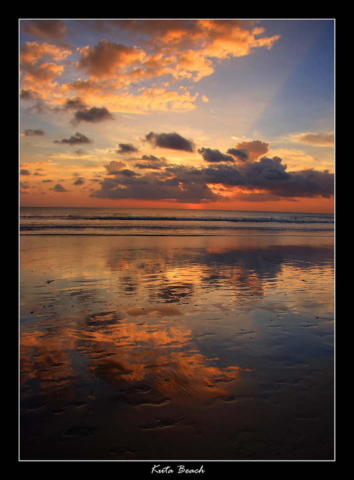 Sunset at the famous Kuta Beach in Bali, it is very difficult to get a shot off without someone in your picture here, there are thousands of people on this small beach, especially around sunset time when everyone wants to watch the sun go down. But I managed to get one good picture off without anyone in it.