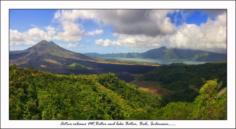 Along my tour on my last day in Bali, the driver took me to a view point of another active volcano called Mt.Batur apparently lava can be seen shooting from this volcano occasionally, but it was pretty calm on this day. this was our final destination of my day tour of Bali, well worth the 8.5 hours in a vehicle and 40 bucks it cost me to hire the guy for the day, if you look closely the black on the volcano is fairly recent hardened magma..and there is a village down there that is in and around the lava flow path..