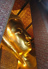 Part of the head of the huge, golden reclining Buddha