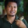 A young man raises abandoned birds.