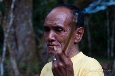 Local man smoking cigarette with a traditional pipe