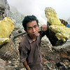 A miner hauls sulfur rock from the bottom of Ijin volcano.