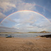 A double rainbow appears over Tanjung A'an beach, east of Kuta.