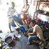 Motorcycle repairmen at work on a bike in the town of Sabang.