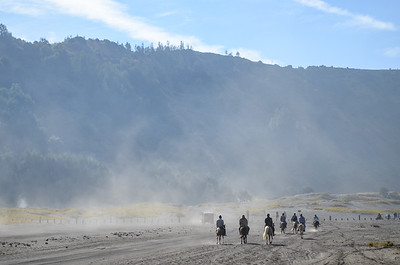 Horsemen on Bromo plain