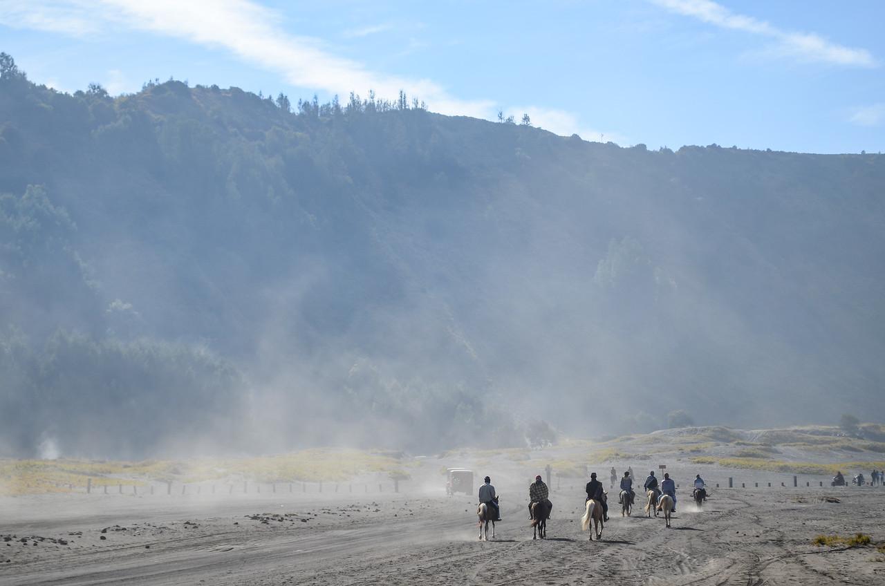 Horsemen on Bromo plain