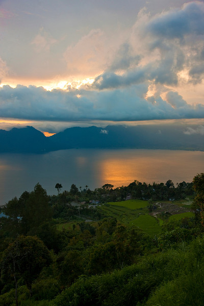 Atop the mountain overlooking Lake Maninjau at sunset. We navigated 44 hairpin turns on our motorcycle to get to the top. The only reason I know this is because each one is numbered with a sign!