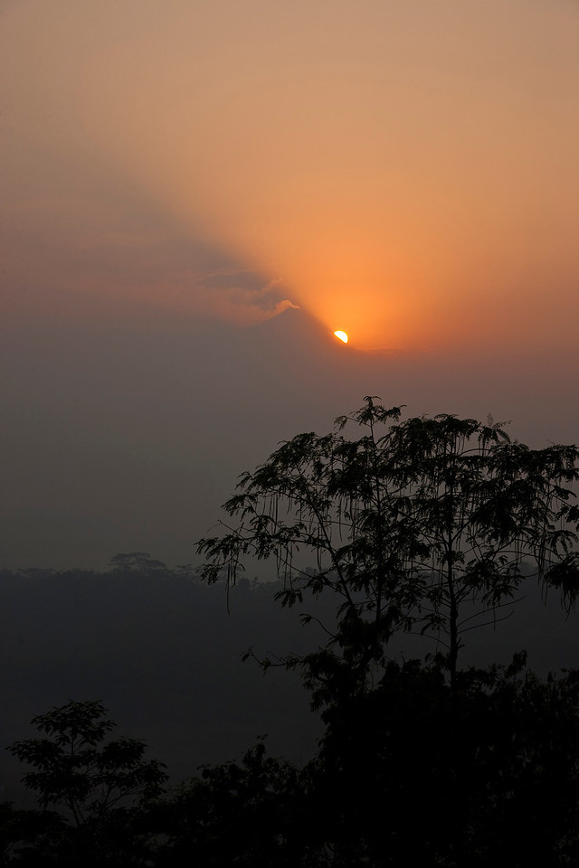 Luckily, the not-so-beautiful things were largely confined to the cities. This is a sunrise over Borobudur, one of the most famous and jaw-dropping (yet non-touristy) temples in the world. If there hadn't been a haze one would have been able to see the temple itself in the distance.