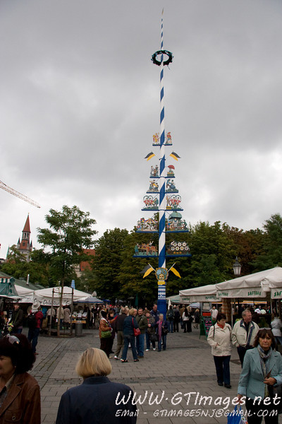 Munich, Germany (Viktualienmarkt)- The May pole. Each town has a pole, and the poles commemorate each town's trade specialties, patron saints, etc. The poles are taken down in early April, for painting/cleaning, and put up by May 1st. It is tradition for a town to steal a neighboring town's May pole, and hold it ransom. Usually beer is a large part of the ransom.