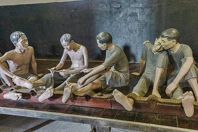 Hanoi Hilton prisoner comforts a fellow prisoner