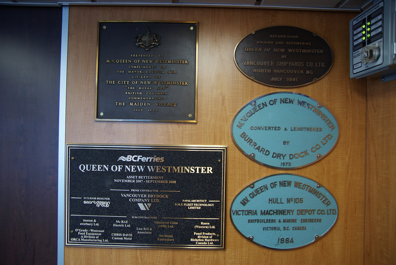 "The many dedication plaques of a long-lived Queen.  Note the recent renovation described as ""asset betterment."""