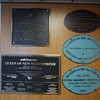 """The many dedication plaques of a long-lived Queen.  Note the recent renovation described as """"asset betterment."""""""
