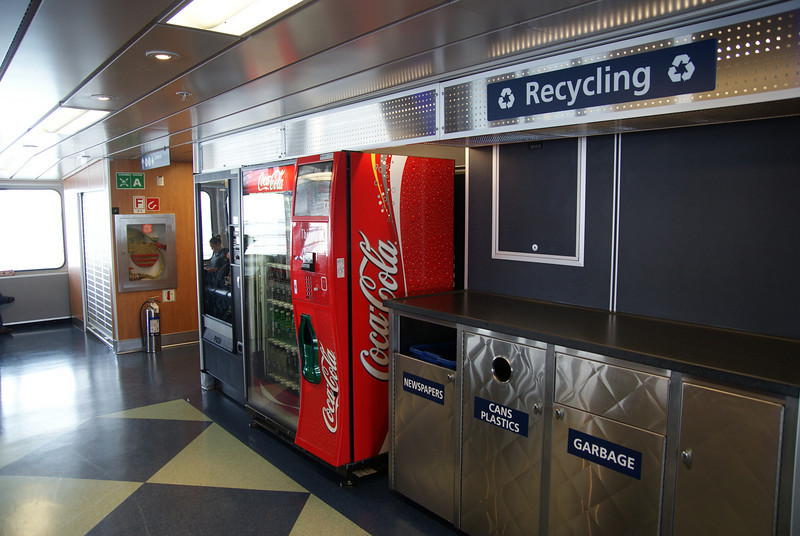 Vending machines and recycling centre at the rear of the forward lounge.
