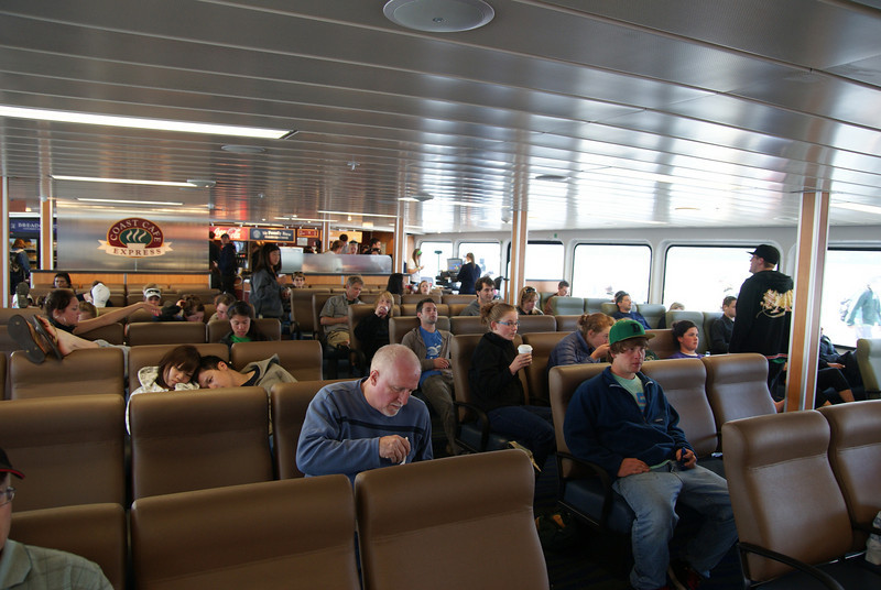 The aft lounge on the upper passenger deck, with snack bar in the back.