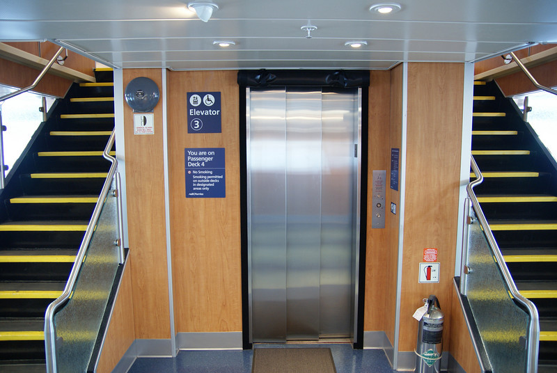 Some of the elevators are awkwardly located, since the new passenger decks had to be built around existing elevator shafts.