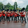 The trumpeters and the Queen's Guard march towards Buckingham Palace.